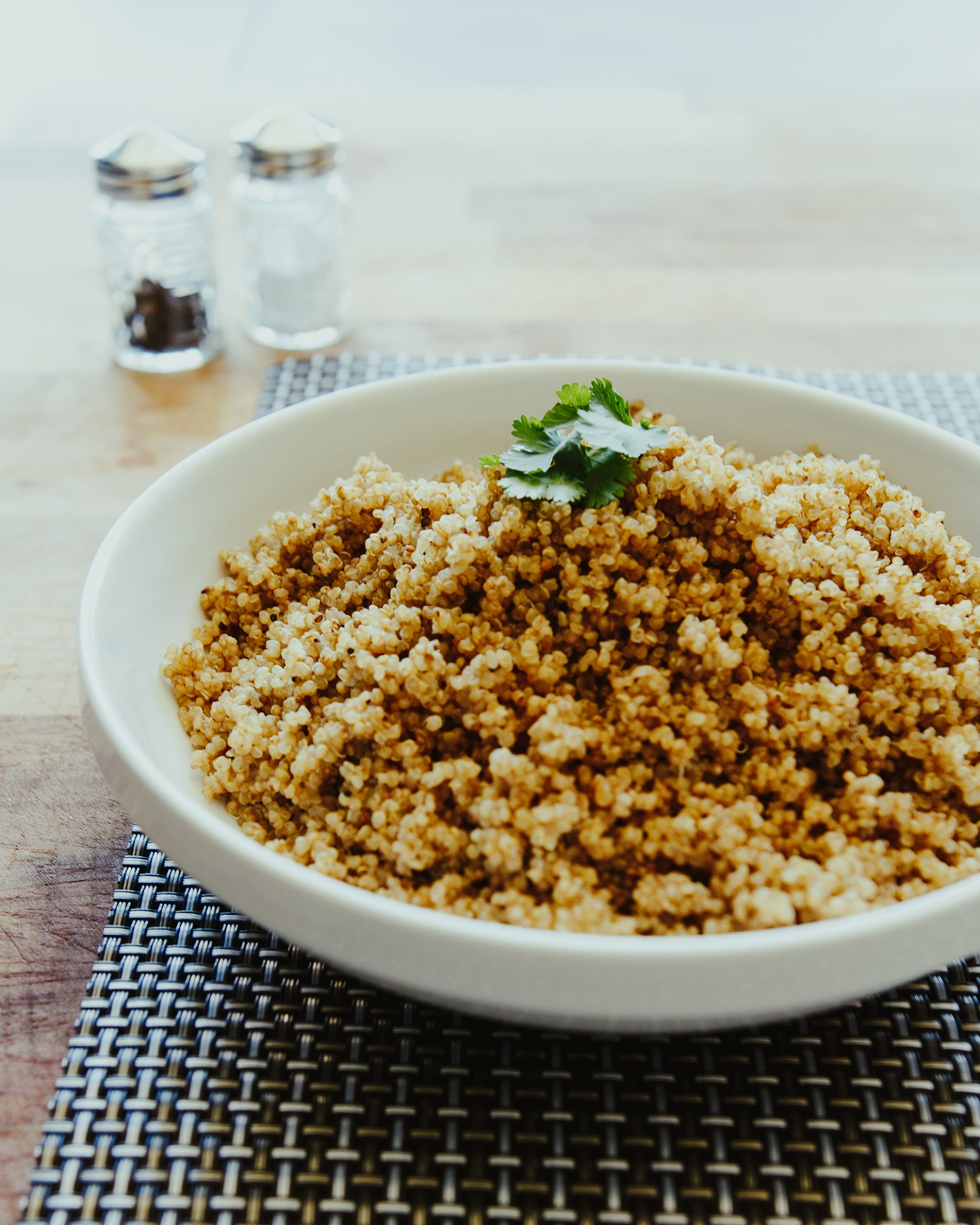 Cooked quinoa in a white bowl