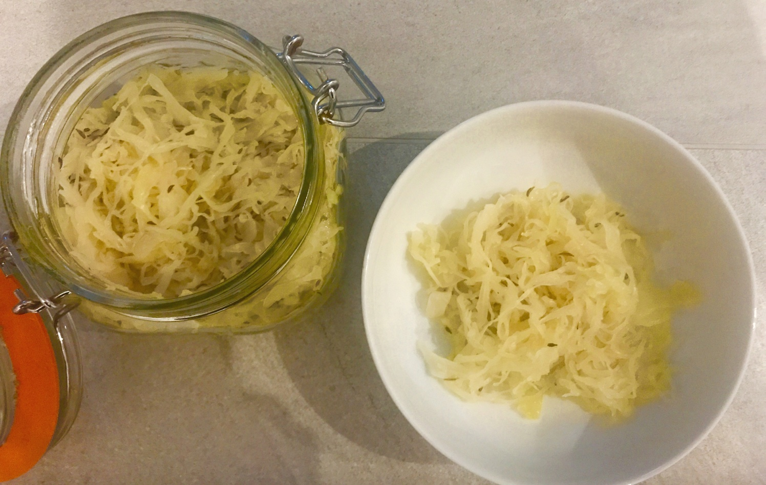 SugarDoctor Recipe Sauerkraut in a glass jar and in a bowl